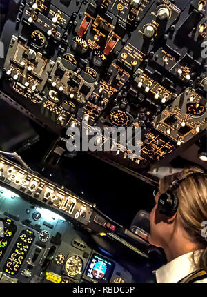 Flight deck. MEET the stunning pilot whose behind the scenes shots of her job and adventurous lifestyle have made her an Instagram star. First officer Sara Johansson (33), Borås, Sweden has amassed more than 22k followers on the social media site thanks to her incredible images. Striking shots show the beauty queen in her uniform at work in the cockpit or chilling on a plane wing while others show Sara on her days off exploring the exotic locations she gets to fly to. Sara has worked as a commercial pilot for two and a half years, flying both passengers and cargo on a Boeing 737 but is now fly - Stock Image