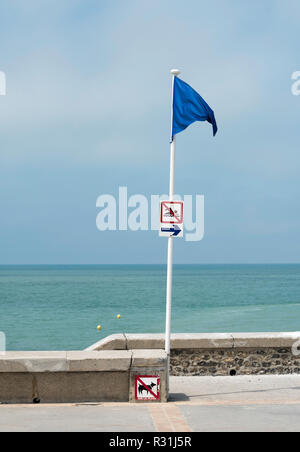Blue flag indicating the limit of the safe bathing zone in the sea at Hautot-sur-Mer,  Seine-Maritime,  Normandy, France, Europe - Stock Image