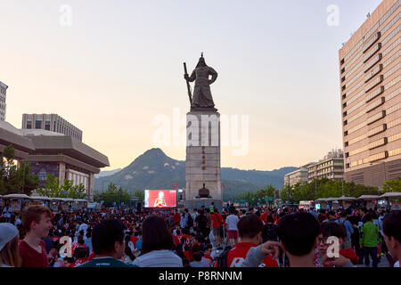Crowd of football fans gather around Statue of Admiral Yi Sun-Shin in Gwanghwamun, Seoul, South Korea, to watch the match between South Korea and Swed - Stock Image