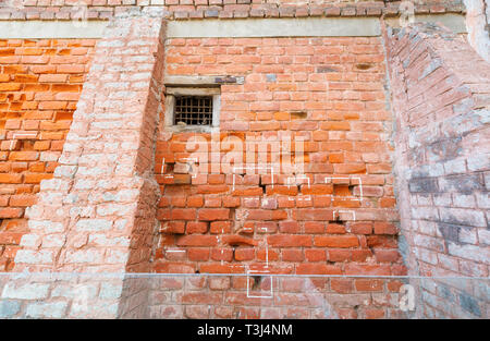 Bullet holes in a brick wall, Jallianwala Bagh, a public garden in Amritsar, Punjab, India, a memorial commemorating the 1919 shooting Jallianwala Bagh Massacre - Stock Image