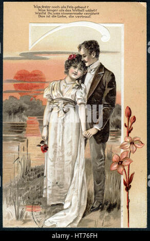 GERMANY - CIRCA 1907: A postcard printed in Germany, shows a couple in love against the backdrop of a beautiful - Stock Image