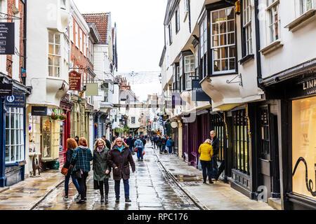 Stonegate York, YO1 8AS, Stonegate, York city, shops, ye olde starre inn york, shopping, York city shopping, history, historic, tourism, York, UK - Stock Image