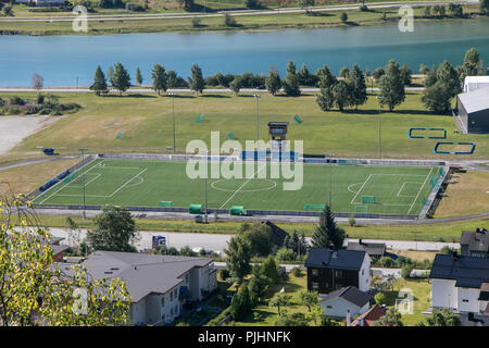 Norway, Andalsnes, July 27, 2018: Sun shines over a local soccer field. - Stock Image