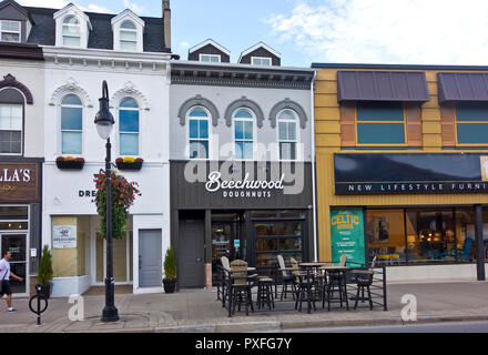 Shops in downtown St. Catharines, Ontario, Canada.  Vegan doughnut shop  and furniture store on St. Paul Street, St. Catharines, ON. - Stock Image