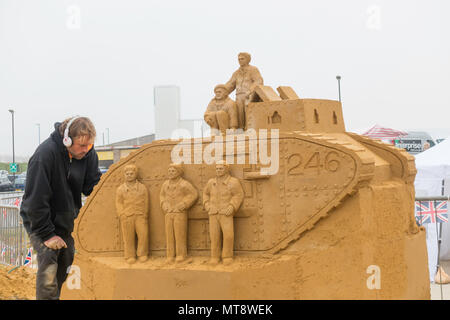 Redcar Cleveland UK 28 May 2018  The seaside town of Redcar on the Yorkshire Coast is commemorating the events of 1918. With construction of Sand Sculptures by an international team of specialists commemorating events by local people during the first World War.  After the war many towns were presented with an army tank, and number 246 was presented to Redcar. Credit: Peter Jordan_NE/Alamy Live News - Stock Image