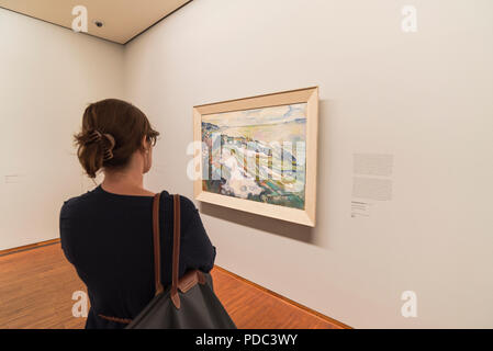 Young woman looking at art in the Albertina gallery, Vienna, Austria - Stock Image