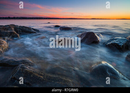 Beautiful December evening by the Oslofjord at Oven, Østfold, Norway. - Stock Image