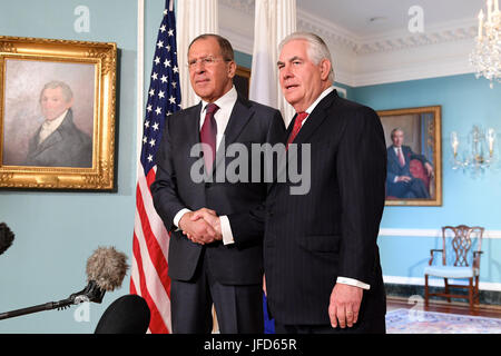 U.S. Secretary of State Rex Tillerson and Russian Foreign Minister Sergey Lavrov shake hands before their bilateral - Stock Image