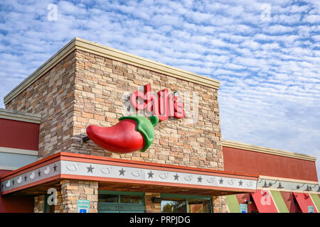 Chili's family restaurant front exterior entrance of the chain restaurant showing the corporate sign and logo in Montgomery, Alabama USA. - Stock Image