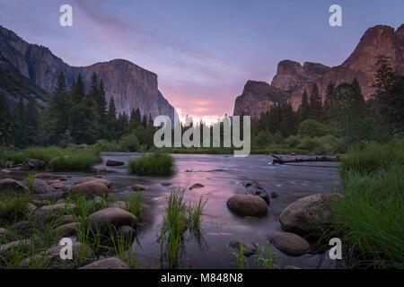 Yosemite Valley and the River Merced at dusk, Yosemite National Park, California, USA. Spring (June) 2015. - Stock Image