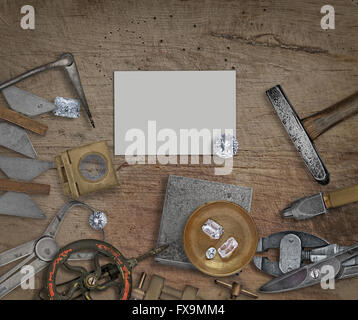 vintage jeweler tools and diamonds on a bench, space for text on business card - Stock Image
