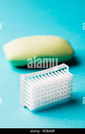 Nail brush and soap. - Stock Image