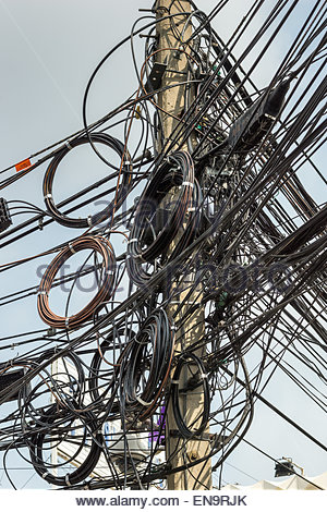 Chaotic electric wiring in Bangkok - Thailand - Stock Image