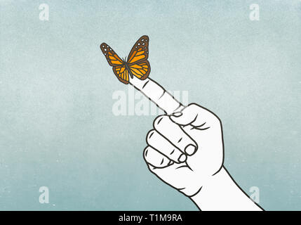 Butterfly on finger - Stock Image