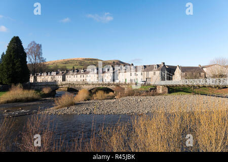 Confluence of the rivers Esk and Wauchope Water, with a row of houses behind in Langholm, Dumfries and Galloway, Scotland, UK - Stock Image