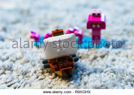 Swiecie, Poland - December 25, 2018: Lego pirate ship and monster in soft focus background on a carpet. - Stock Image