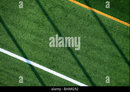 image of aerial view of green astroturf surface on sports playing field - Stock Image