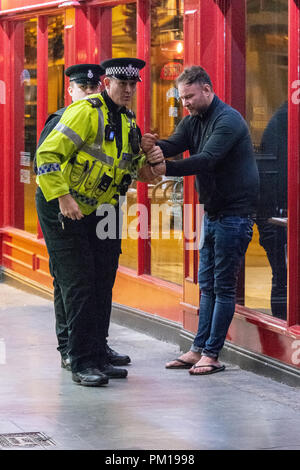 Salisbury Wiltshire, England, 16th September 2018  A man is arrested for being drunk and disorderly at the police barrier for suspected novichok incident in Prezzos Salisbury.  He had repeated sworn at police, used abusive language and attempted to cross the cordon   Credit Estelle Bowden/Alamy news Credit: Starsphinx/Alamy Live News - Stock Image