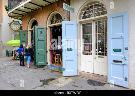 Front doors of Faulkner House Books, bookstore selling William Faulkner's books, Pirate's Alley, New Orleans French Quarter, New Orleans, USA - Stock Image