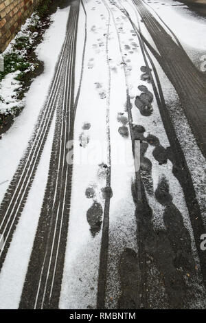 Tracks in light covering of snow - Stock Image