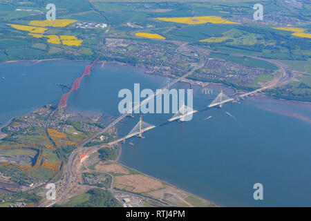 Aerial view of the Queensferry Crossing bridge during construction with Forth Rail Bridge and Forth Road Bridge, Queensferry, Edinburgh, Scotland, UK - Stock Image