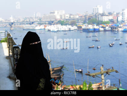 A veiled Bangladeshi garment factory worker in Dhaka, Bangladesh. - Stock Image