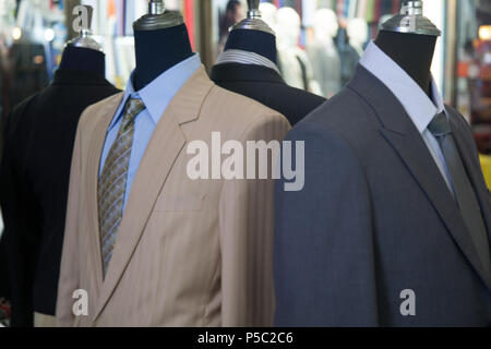 Handmade Suits on Mannequins Display, Bangkok, Thailand. - Stock Image