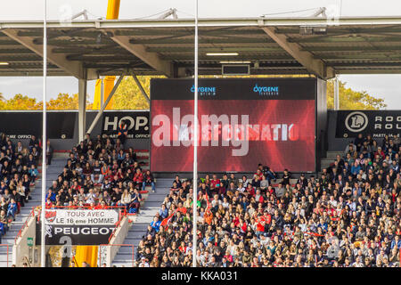 Spectators on the terraces of Ernest Wallon stadium, home ground of Stade Toulousain rugby union team, Toulouse, - Stock Image