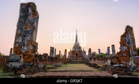 Tilt-Shift for background, Ancient ruins and pagoda of Wat Phra Si Sanphet old temple famous attractions during - Stock Image