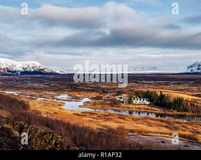 Sunlight shining on the church in the rift valley at Thingvellir in central Iceland - Stock Image