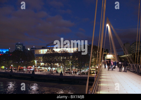 Hungerford Bridge and Royal Festival Hall London at night - Stock Image