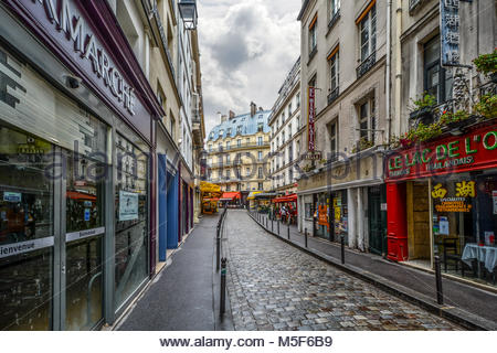 Early morning in the Latin Quarter of Paris France with shops not open and clouds in the sky - Stock Image