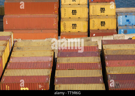 Stacked shipping containers on dock in La Spezia commercial port, La Spezia province, Italy, Europe - Stock Image