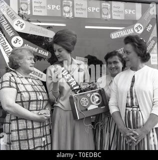 1964, Australian food, lady getting feedbacl from female shoppers, England, UK. - Stock Image