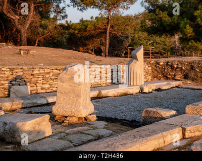 Old ruins and stones carved in the old greek language at the archeological site near Aliki Marble Port on Thasos Island, Greece - Stock Image