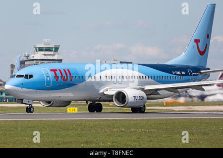 TUI Airways Boeing 737-800 aircraft, registration G-TAWC, preparing for take off from Manchester Airport, England. - Stock Image