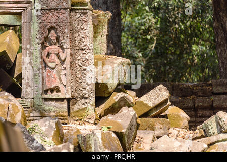 Aspara on a wall as parts lie in ruins at the Unesco World Heritage site of Ankor Thom, Siem Reap, Cambodia - Stock Image