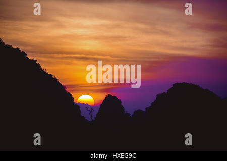 Beautiful sunrise or sunset in mountains. Phangnga province, Thailand. Space for text - Stock Image