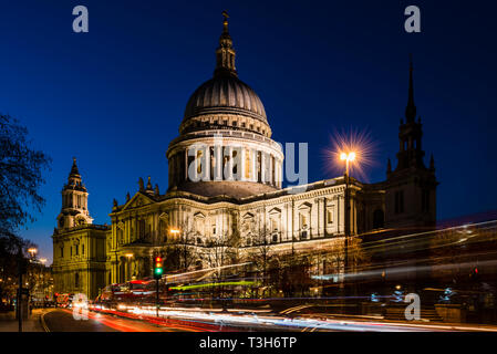 Traffic in front of St Paul's Cathedral after dusk, London, UK - Stock Image