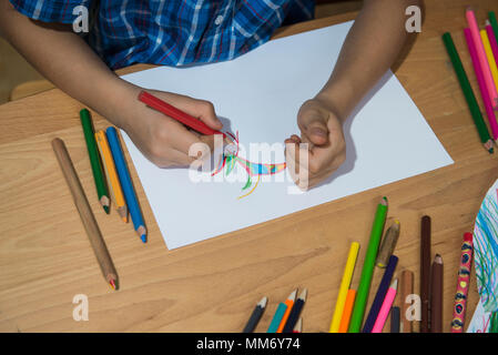 Close-up of a boy's hand coloring, Munich, Germany - Stock Image
