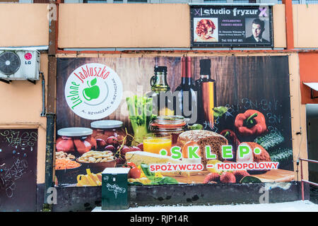 Mural photograph advertising a food and alcohol shop, Gdańsk, Poland - Stock Image