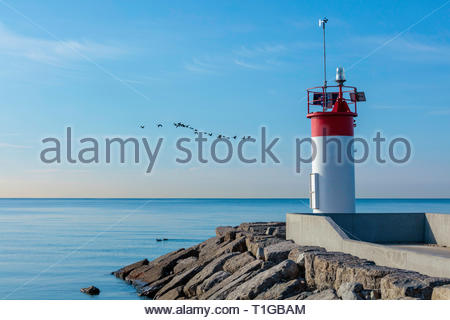 Lighthouse beacon marker inland waterway on Lake Ontario at the entrance to Frenchman's Bay at Pickering Ontario Canada - Stock Image