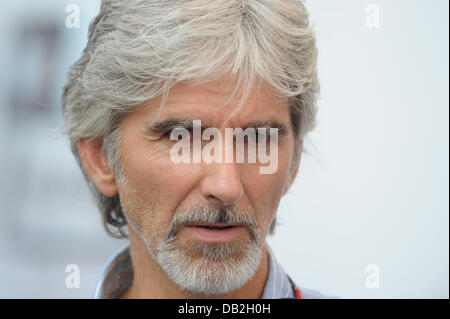 Former British Formula One champion Damon Hill walks through the paddock at the race track Autodromo Nazionale Monza, - Stock Image