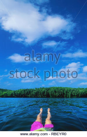 Daydreaming floating in the lake in summer in Haliburton Ontario Canada - Stock Image