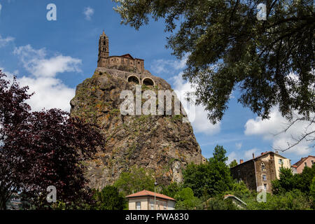 Chapel of St Michel-dAiguilhe in the city of Le Puy-en-Velay in the Auvergne-Rhone-Alpes region of south-central France. Built in 969 on a volcanic pl - Stock Image
