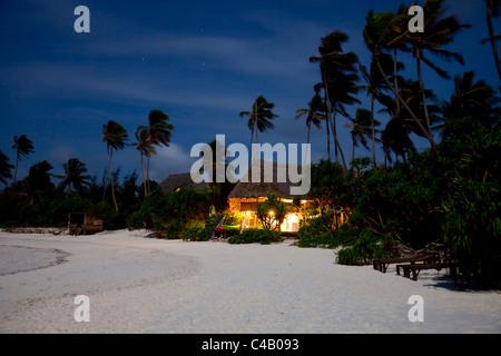 Zanzibar, Matemwe Bungalows. The lights of the dive centre at Matemwe Bungalows on a balmy evening. - Stock Image