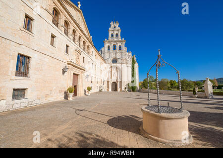 perspective of facade of Monastery Santa Maria de la Vid, church and water well, landmark and monument in Burgos, Castile and Leon, Spain, Europe - Stock Image