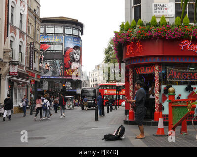 Tourists walk the streets of Chinatown in London, England - Stock Image
