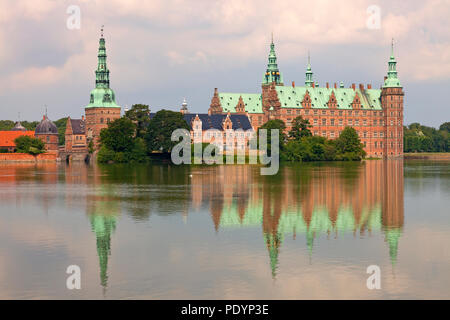 Frederiksborg Castle seen from the opposite bank of the Castle Lake - Stock Image