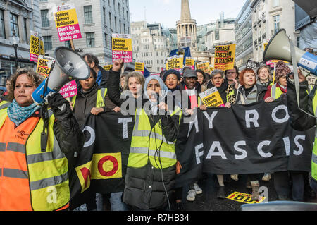 London, UK. 9th Dec, 2018. The march starts for the united counter demonstration by anti-fascists in opposition to Tommy Robinson's fascist pro-Brexit march with a banner held by women. The march which included both remain and leave supporting anti-fascists gathered at the BBC to to to a rally at Downing St. Police had issued conditions on both events designed to keep the two groups well apart. Credit: Peter Marshall/Alamy Live News - Stock Image